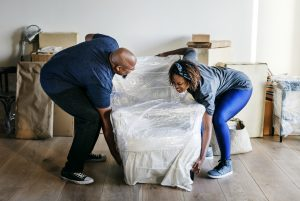 Two people moving a chair - moving injuries
