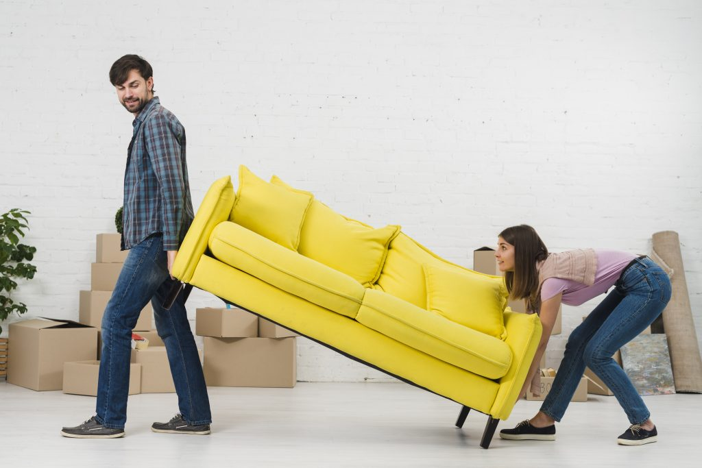two people moving a couch