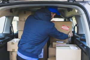 mover loading a car with boxes