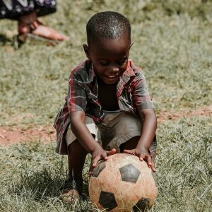 A boy playing with a ball.