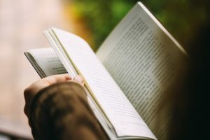 Actors moving to Ontario are reading books.