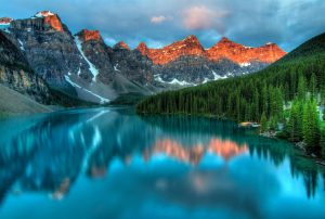 A view of the beautiful mountains by the lake people love after moving in Canada.