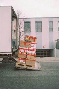 A pile of moving boxes ready to be uploaded on the moving truck.