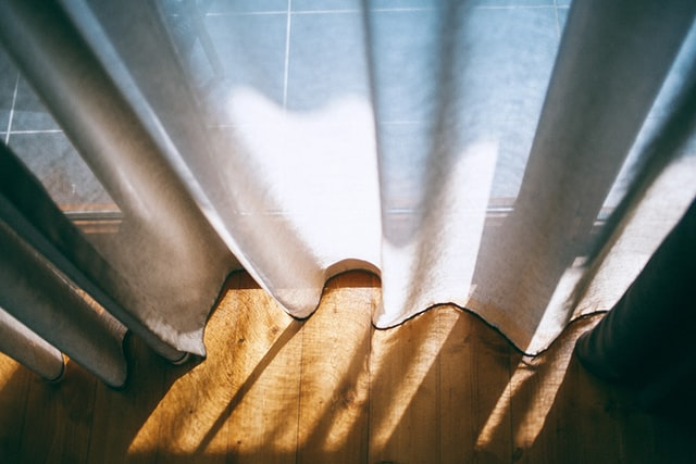 White curtains as a way to quickly cozy up your new Toronto apartment