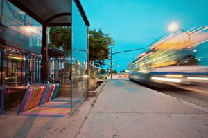 A bus station and a bus passing by