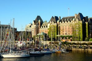 A photo depicting a building near a harbor in Victoria