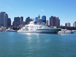A yacht in Boston, one of the places that you should consider when moving to New England region.